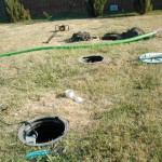 Locating and uncovering septic tanks