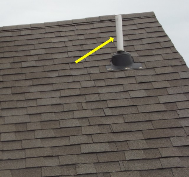 Roof termination of a plumbing vent pipe.